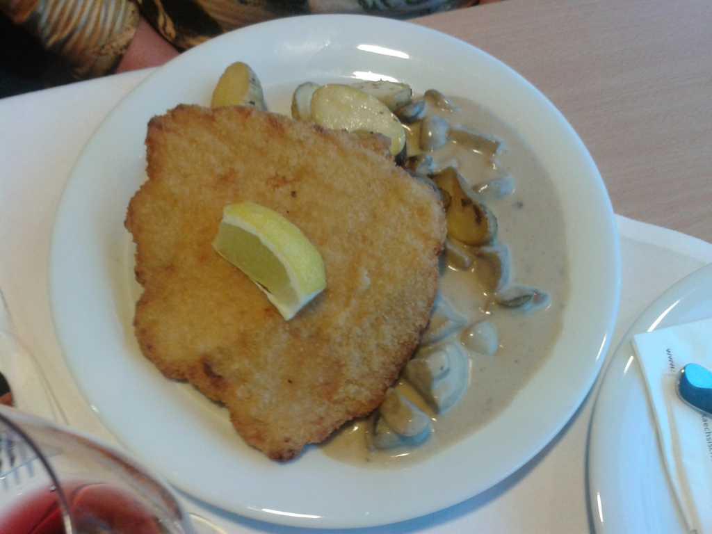 Schnitzel mit Champion und Kartoffelstückchen