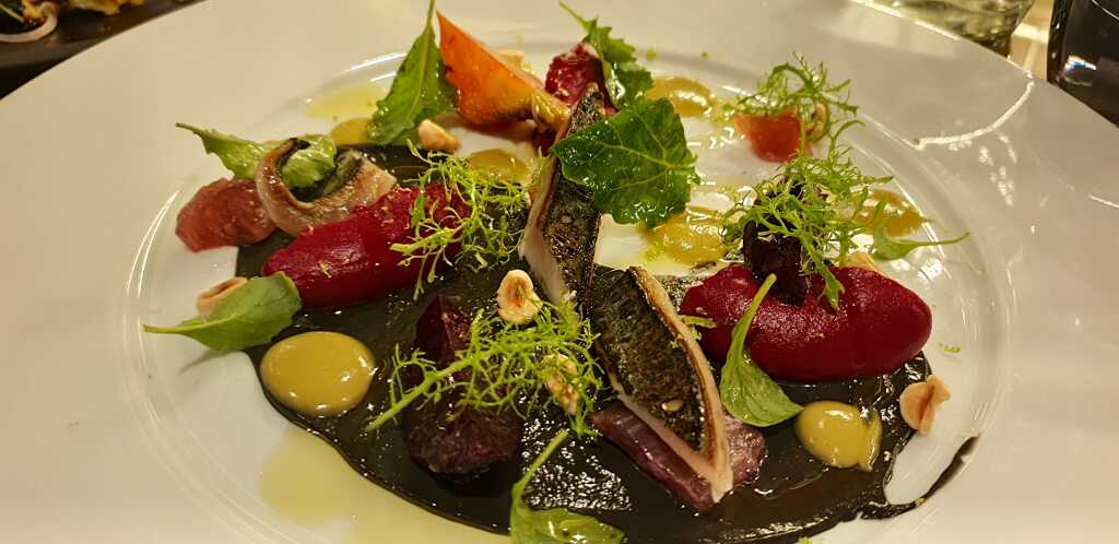 Freekeh Eggplant cream, green vegetables, tahini, Greek yogurt, seeds, parsley coulis with Seabass filet