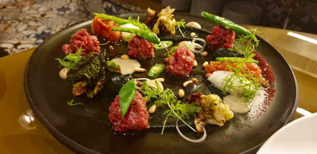 Layla Tartar  Chopped raw veal, smoked eggplant cream, yogurt, chopped tomatoes, fresh greens, sumac, tahini, olive oil